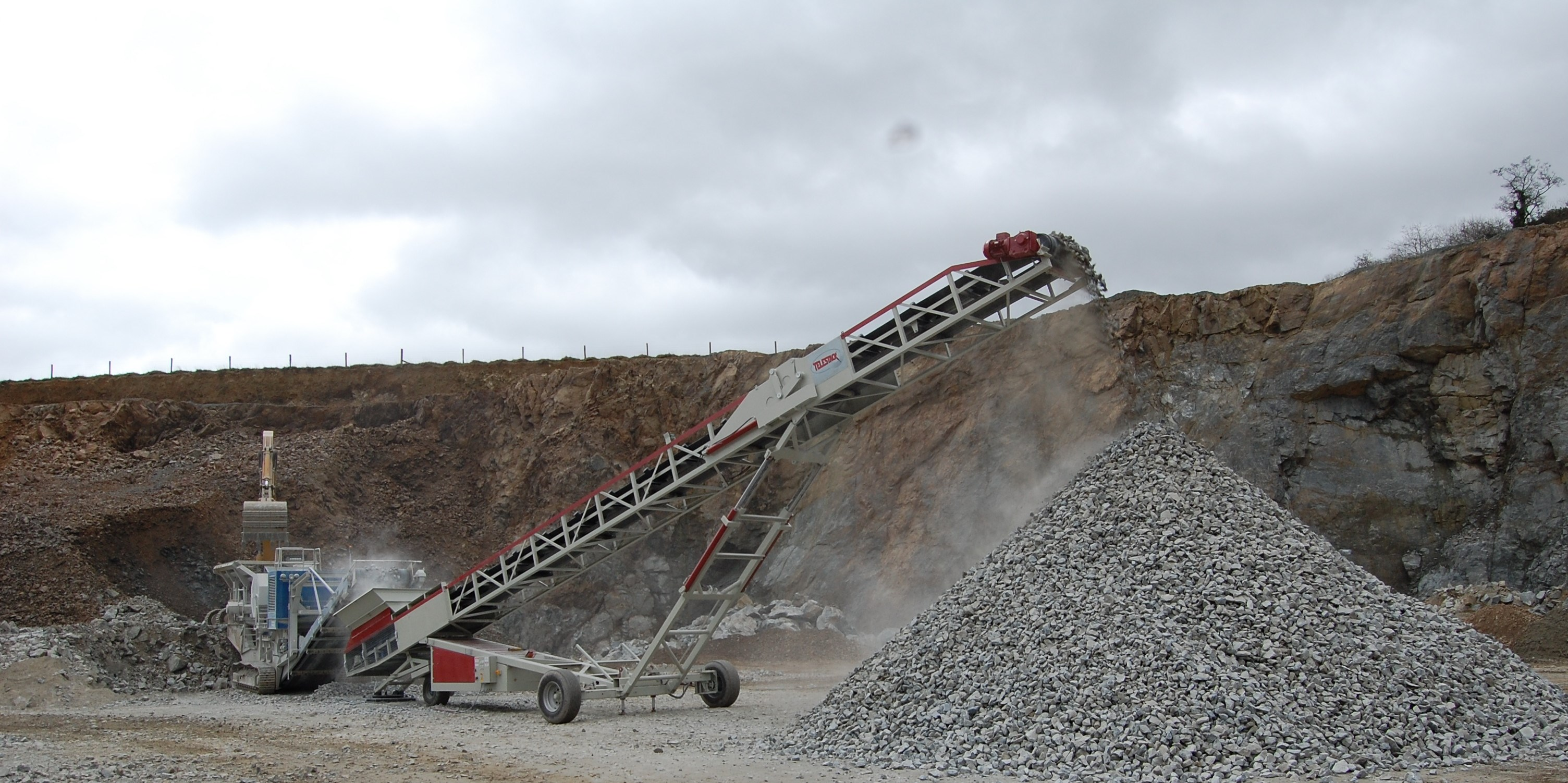 AggStack RS wheeled stacker stockpiling from mobile crusher_screen